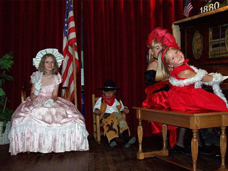 1880 Town Costume Rentals - Kids on stage at the piano